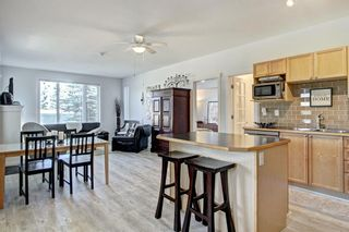Photo 2: 401 8000 Wentworth Drive SW in Calgary: West Springs Row/Townhouse for sale : MLS®# A1148308
