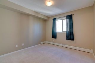 Photo 16: 9302 403 MACKENZIE Way SW: Airdrie Apartment for sale : MLS®# A1032027