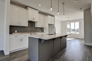 Photo 9: 136 Creekside Drive SW in Calgary: C-168 Semi Detached for sale : MLS®# A1108851