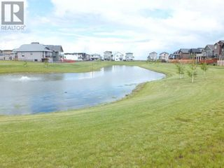 Photo 33: 504 Greywolf Cove N in Lethbridge: House for sale : MLS®# A1153214