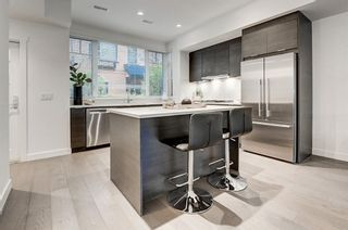 Photo 2: 303 1818 14A Street SW in Calgary: Bankview Row/Townhouse for sale : MLS®# C4303563