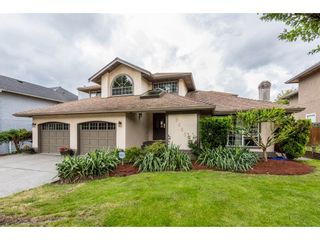 """Photo 1: 8265 148B Street in Surrey: Bear Creek Green Timbers House for sale in """"Shaughnessy Estates"""" : MLS®# R2183721"""