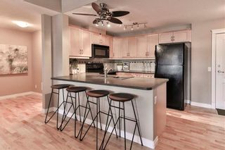 Photo 2: 111 2121 98 Avenue SW in Calgary: Palliser Apartment for sale : MLS®# A1076352