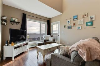 Photo 1: 1409 604 East Lake Boulevard NE: Airdrie Apartment for sale : MLS®# A1057063