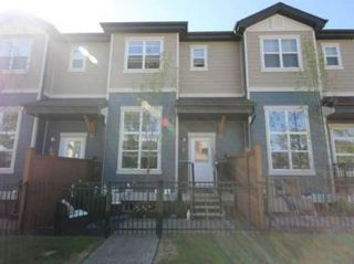 Main Photo: 2 1302 Russell Road NE in Calgary: Renfrew Row/Townhouse for sale : MLS®# A1146794