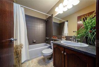 Photo 13: 77 WEST EDGE Road: Cochrane House for sale : MLS®# C4177581