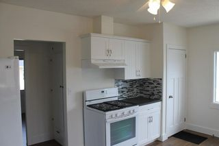Photo 9: 1014 Nanton Avenue: Crossfield House for sale : MLS®# C4123826