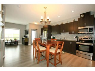 Photo 4: 510 RIVER HEIGHTS Crescent: Cochrane House for sale : MLS®# C4074491