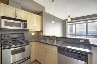 Photo 12: 4 145 Rockyledge View NW in Calgary: Rocky Ridge Apartment for sale : MLS®# A1041175