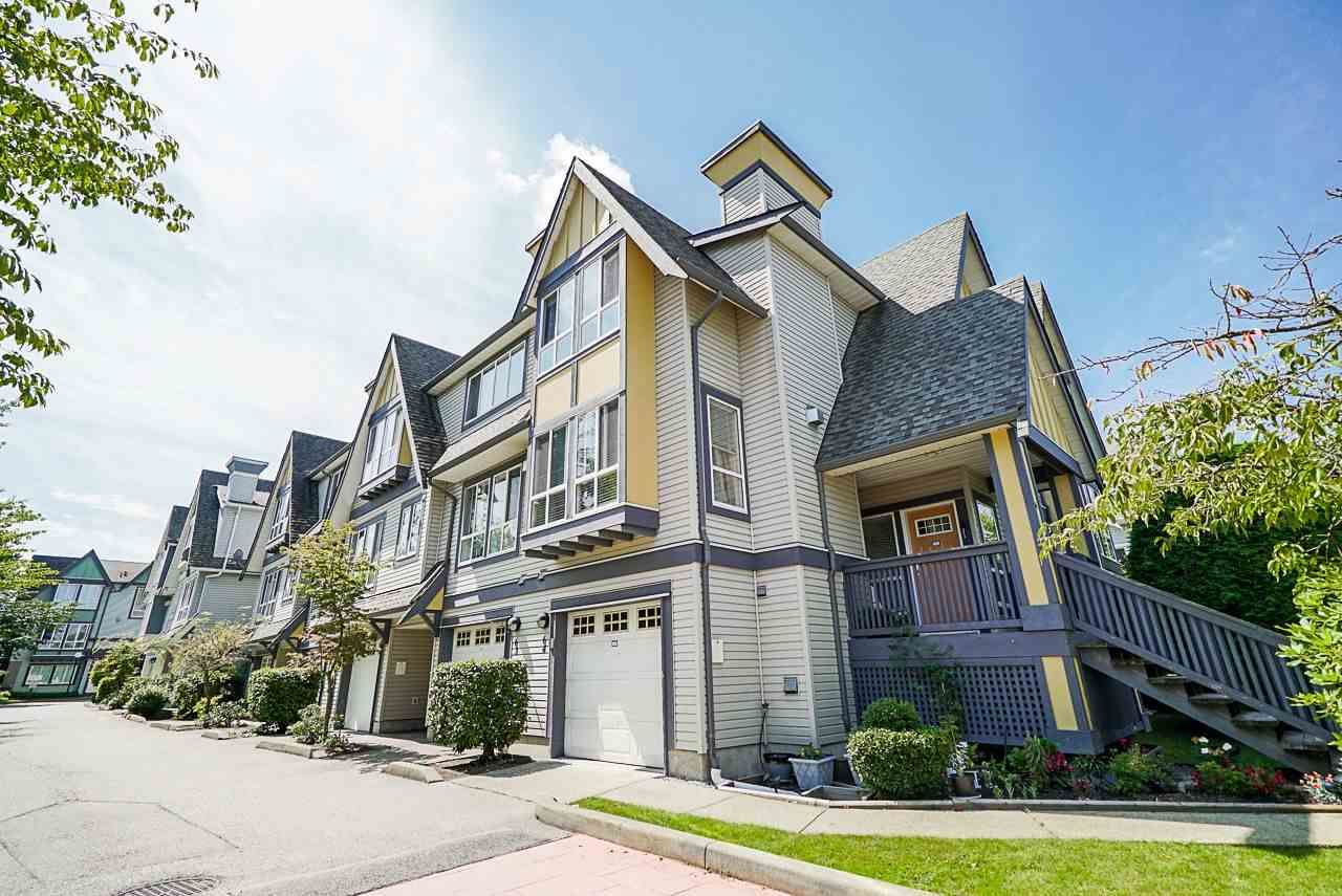 "Main Photo: 64 16388 85 Avenue in Surrey: Fleetwood Tynehead Townhouse for sale in ""CAMELOT VILLAGE"" : MLS®# R2486322"