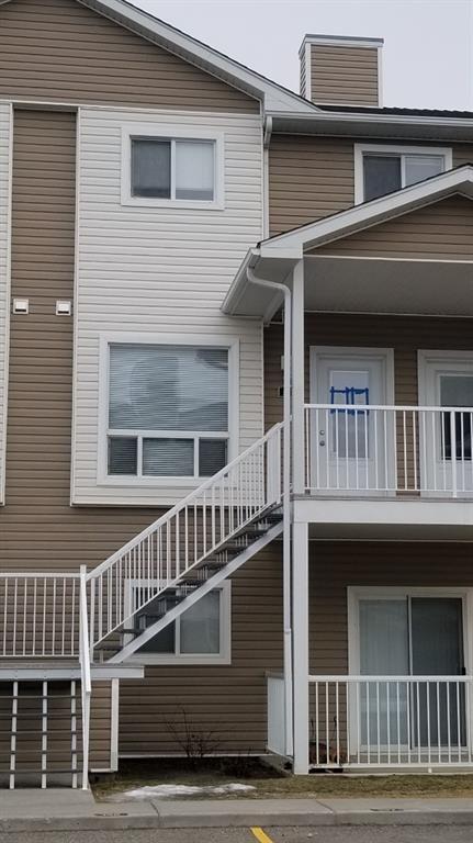 Main Photo: 321 Sunrise Terrace NE: High River Row/Townhouse for sale : MLS®# A1062467