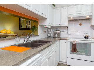 "Photo 7: 414 13860 70TH Avenue in Surrey: East Newton Condo for sale in ""Chelsea Gardens"" : MLS®# F1448214"