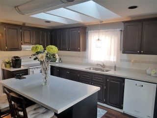 """Photo 2: 98 1840 160 Street in Surrey: King George Corridor Manufactured Home for sale in """"Breakaway Bays"""" (South Surrey White Rock)  : MLS®# R2312911"""