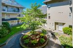 Main Photo: 111 1570 PRAIRIE Avenue in Port Coquitlam: Glenwood PQ Condo for sale : MLS®# R2619575