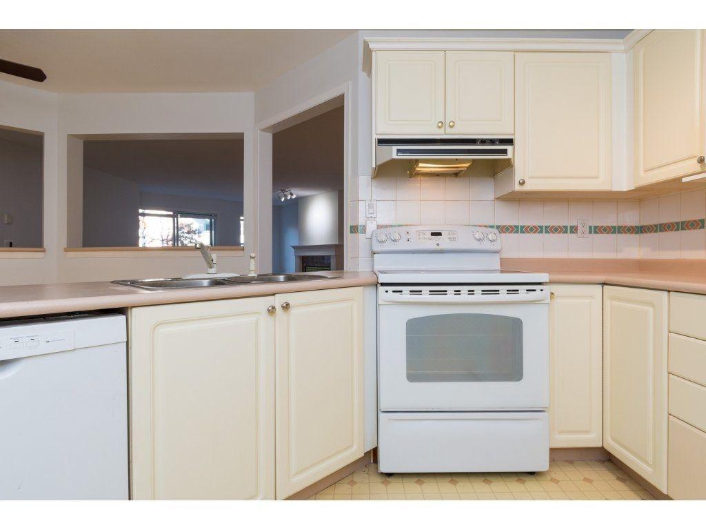 "Photo 11: Photos: 211 12633 72 Avenue in Surrey: West Newton Condo for sale in ""College Park"" : MLS®# R2226813"