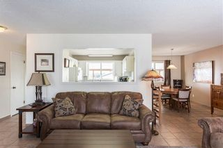 Photo 4: 65 OKOTOKS Drive: Okotoks House for sale : MLS®# C4175424