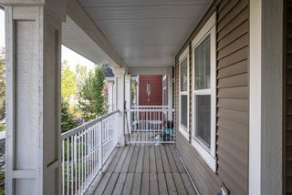 Photo 3: 122 Sunset Road: Cochrane Row/Townhouse for sale : MLS®# A1127717