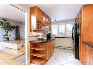 """Photo 12: 844 W 7TH AVE - LISTED BY SUTTON CENTRE REALTY in Vancouver: Fairview VW Townhouse for sale in """"WILLOW CASTLE"""" (Vancouver West)  : MLS®# V1106691"""
