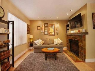 """Photo 3: 38 2736 ATLIN Place in Coquitlam: Coquitlam East Townhouse for sale in """"CEDAR GREEN ESTATES"""" : MLS®# V1137675"""