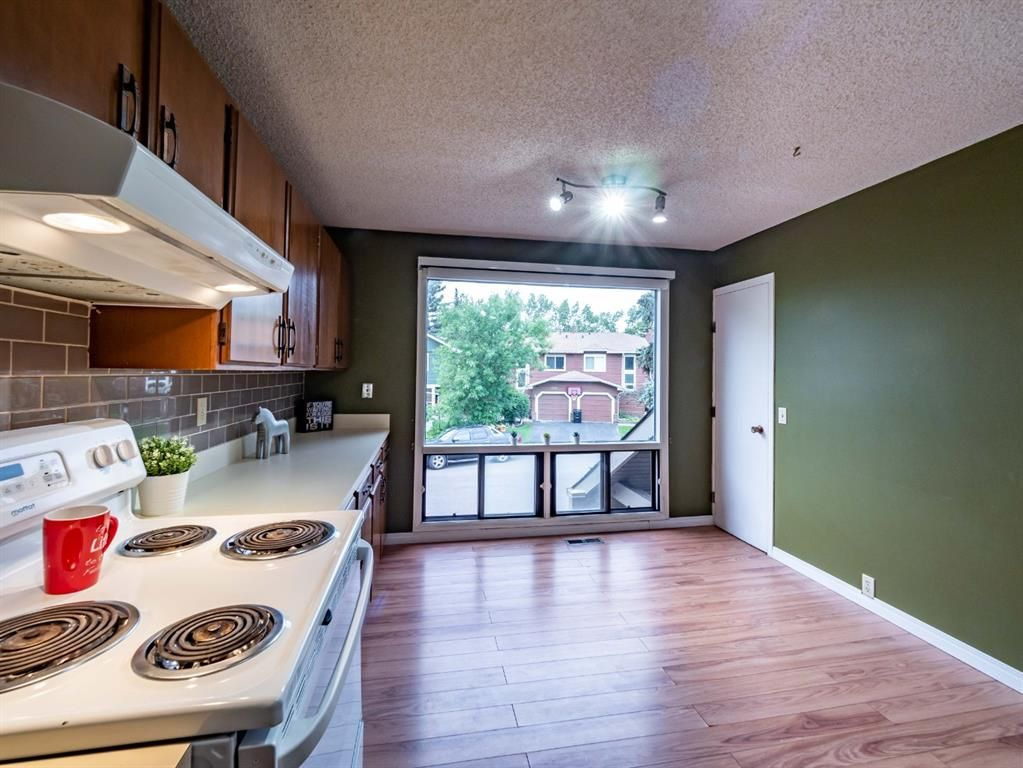 Photo 14: Photos: 32 99 Midpark Gardens SE in Calgary: Midnapore Row/Townhouse for sale : MLS®# A1092782