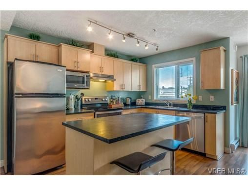 Updated kitchen with new Stainless Steel appliances and custom m