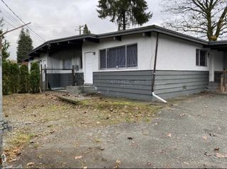Photo 1: 21896 LOUGHEED Highway in Maple Ridge: West Central Duplex for sale : MLS®# R2541847