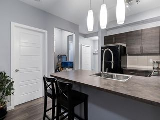 Photo 8: 213 207 SUNSET Drive: Cochrane Apartment for sale : MLS®# A1026900