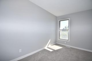 Photo 22: 5 903 67 Avenue SW in Calgary: Kingsland Row/Townhouse for sale : MLS®# A1115343