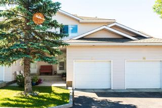 Photo 1: 12 604 GRIFFIN Road W: Cochrane Row/Townhouse for sale : MLS®# A1071749