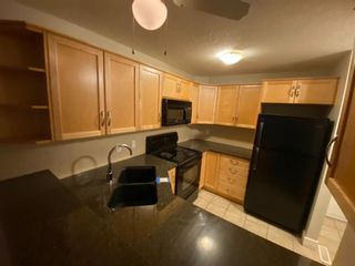 Photo 4: 147 54 Glamis Green SW in Calgary: Glamorgan Row/Townhouse for sale : MLS®# A1076513