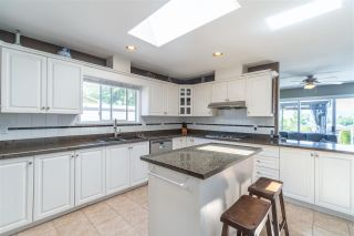 Photo 7: 7807 ELWELL Street in Burnaby: Burnaby Lake House for sale (Burnaby South)  : MLS®# R2591903