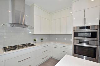 Photo 6: 154 21 Avenue NW in Calgary: Tuxedo Park Row/Townhouse for sale : MLS®# A1098746