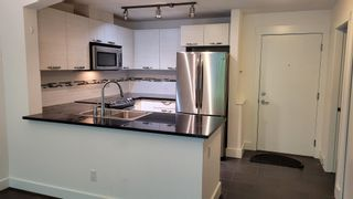 """Photo 1: 211 7478 BYRNEPARK Walk in Burnaby: South Slope Condo for sale in """"GREEN-WINTER"""" (Burnaby South)  : MLS®# R2601787"""