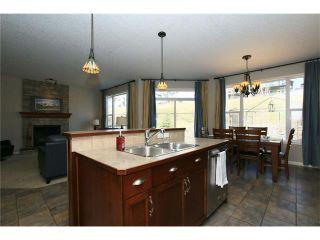 Photo 16: 188 SUNSET Close: Cochrane House for sale : MLS®# C4115906