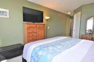 Photo 15: 169 ROCKY RIDGE Cove NW in Calgary: Rocky Ridge House for sale : MLS®# C4140568