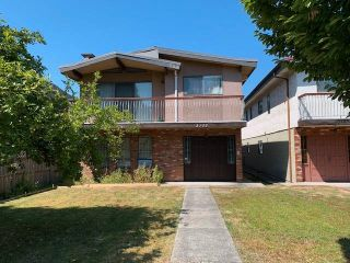 Photo 1: 2177 E 1ST Avenue in Vancouver: Grandview Woodland House for sale (Vancouver East)  : MLS®# R2590021