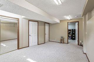 Photo 25: 426 Riverview Green: Cochrane Detached for sale : MLS®# A1132015