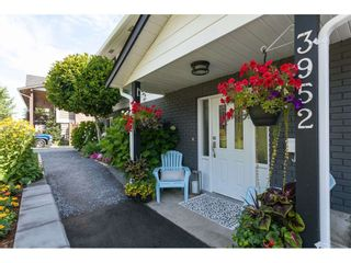 """Photo 2: 3952 205B Street in Langley: Brookswood Langley House for sale in """"Brookswood"""" : MLS®# R2486074"""