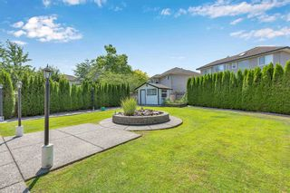 """Photo 38: 7439 146 Street in Surrey: East Newton House for sale in """"Chimney Heights"""" : MLS®# R2602834"""
