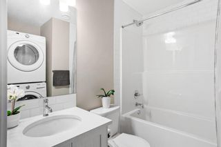Photo 12: 109 Cranbrook Walk SE in Calgary: Cranston Row/Townhouse for sale : MLS®# A1062566