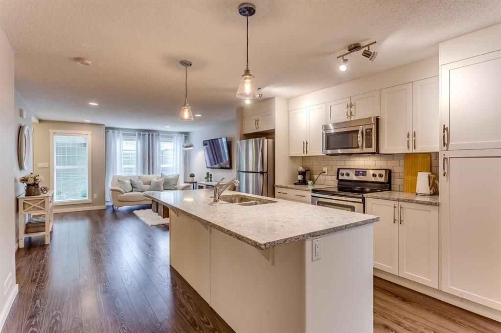 Main Photo: 218 Cranford Mews SE in Calgary: Cranston Row/Townhouse for sale : MLS®# A1127367
