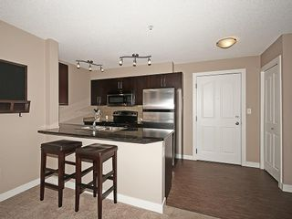 Photo 3: 2211 403 MACKENZIE Way SW: Airdrie Condo for sale : MLS®# C4115283