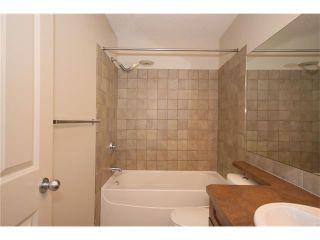 Photo 30: 103 WEST POINTE Court: Cochrane House for sale : MLS®# C4042878