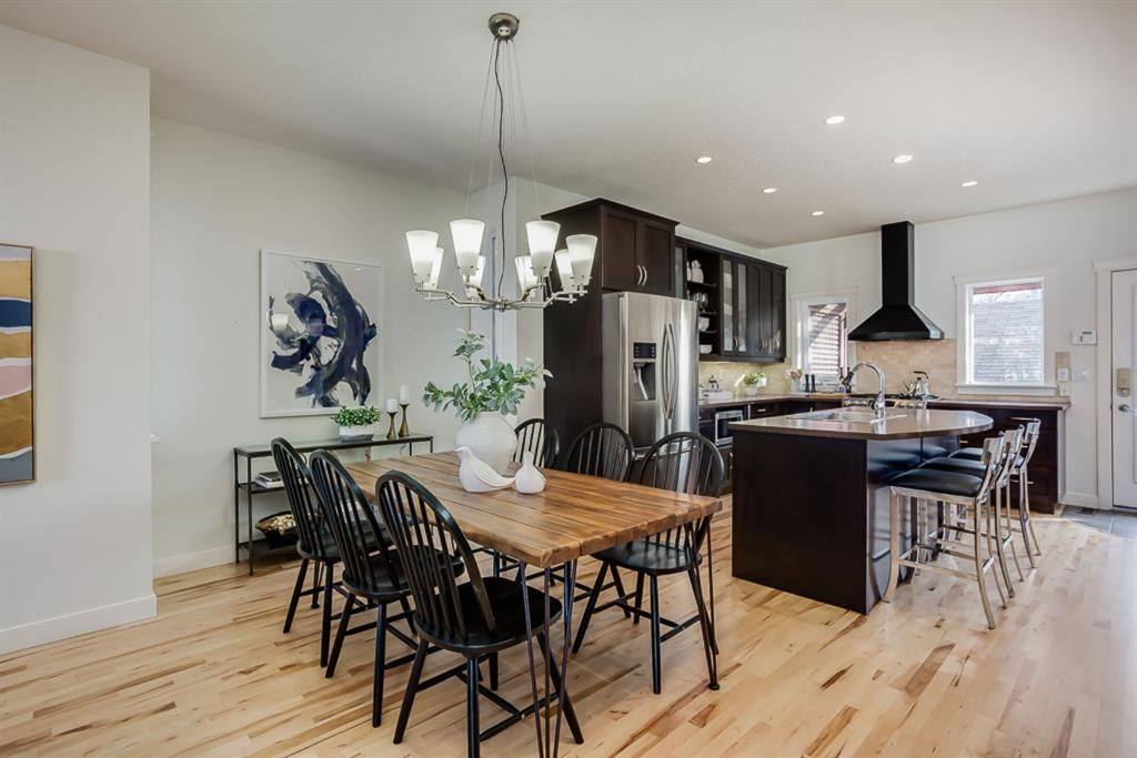 Photo 5: Photos: 219 Somme Manor SW in Calgary: Garrison Woods Detached for sale : MLS®# A1041747