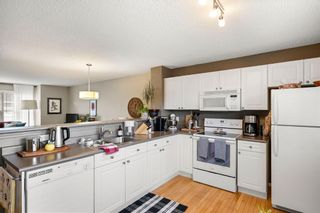 Photo 14: 69 Tuscany Springs Gardens NW in Calgary: Tuscany Row/Townhouse for sale : MLS®# A1112566