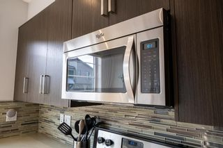 Photo 6: 393 WALDEN Drive SE in Calgary: Walden Row/Townhouse for sale : MLS®# A1126441