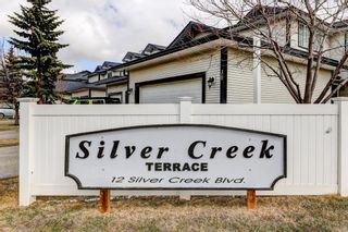 Photo 32: 15 12 Silver Creek Boulevard NW: Airdrie Row/Townhouse for sale : MLS®# A1090078