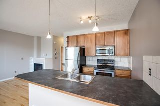 Photo 10: 8 Everridge Gardens SW in Calgary: Evergreen Row/Townhouse for sale : MLS®# A1041120