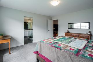 Photo 18: 224 Crestmont Drive SW in Calgary: Crestmont Detached for sale : MLS®# A1118392