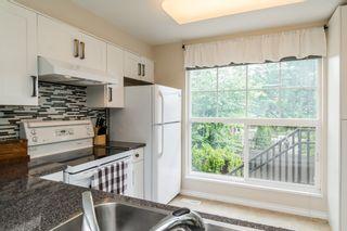 "Photo 13: 802 9118 149 Street in Surrey: Bear Creek Green Timbers Townhouse for sale in ""WILDWOOD GLEN"" : MLS®# R2176341"